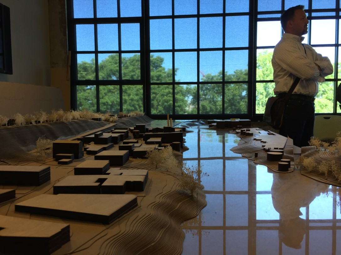 Metro Principal Regional Planner, Dave Elkin looks on from the site model as studio instructor Becca Cavell explains student work (Credit Eric Hawkinson).